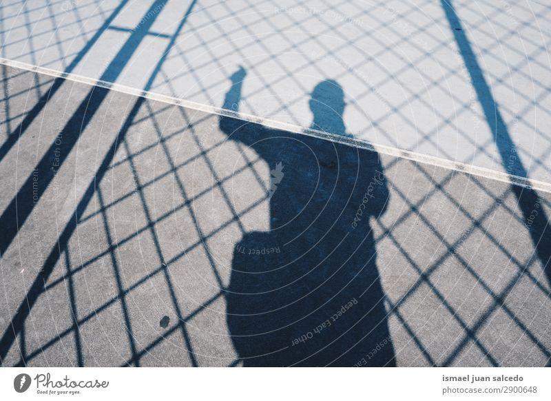 boy shadow silhouetete on the ground Human being Man Sun Street Boy (child) Ground Spain Fence City Minimal Bilbao