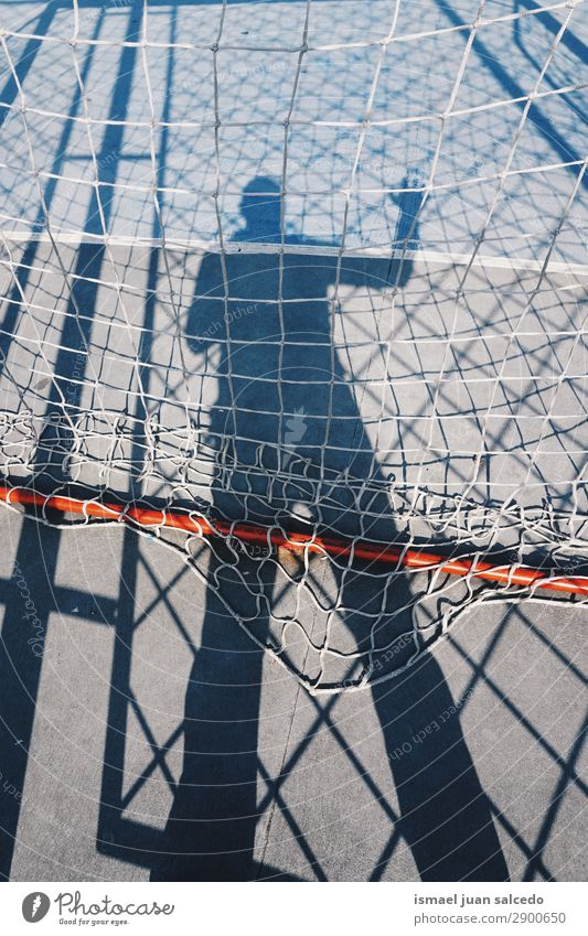 man shadow silhouette on the soccer field Silhouette Human being Man Shadow Light (Natural Phenomenon) Sun Street Soccer Sports Playing field Goal Ground