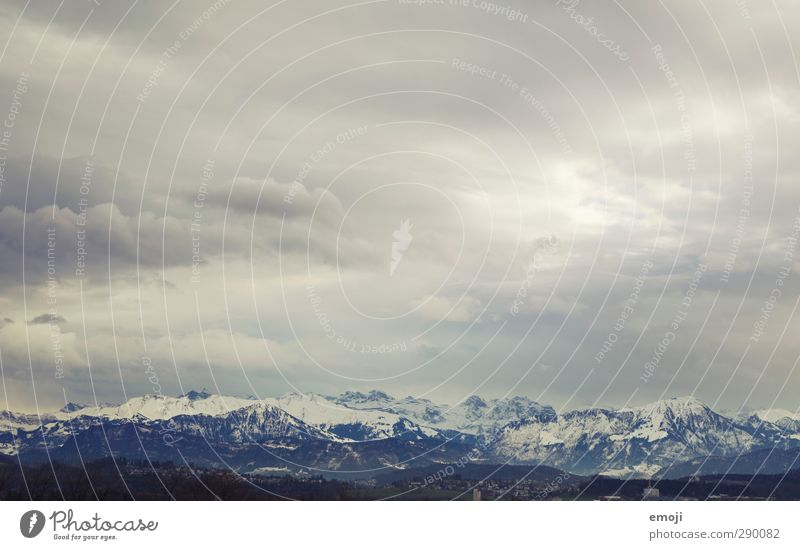 Mountains [CH] Environment Nature Sky Clouds Winter Climate Weather Bad weather Peak Snowcapped peak Dark Cold Blue White Alps Switzerland Colour photo