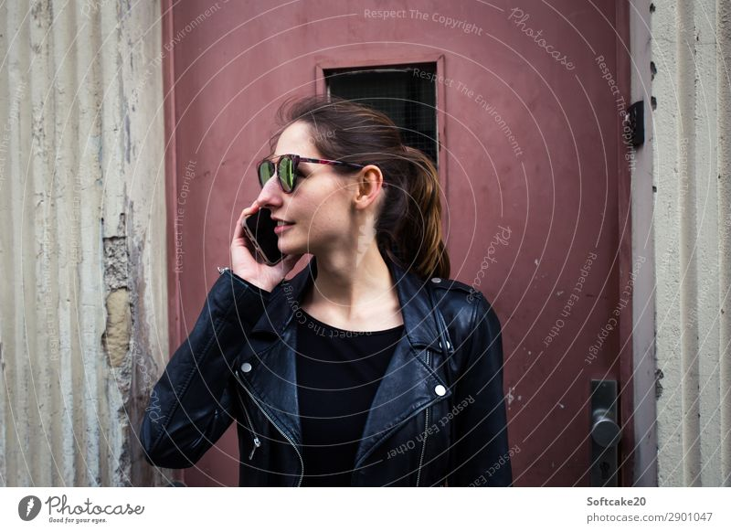 make a phone call Lifestyle Design Telephone Cellphone Entertainment electronics High-tech Human being Feminine Young woman Youth (Young adults) Adults 1