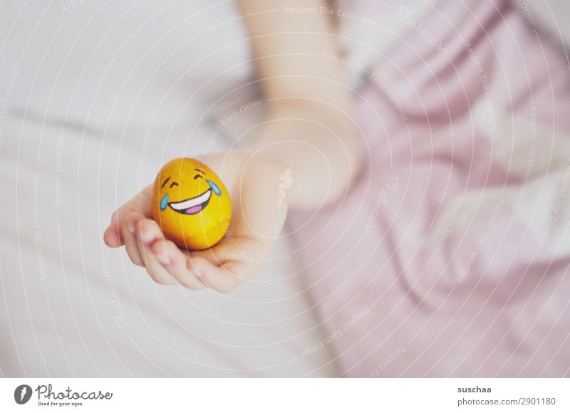 Easter approaches ... Easter egg Egg Painted Smiley Laughter Joke Funny Youth (Young adults) Young woman Child Bed Bedclothes Comfortable Fatigue Illness