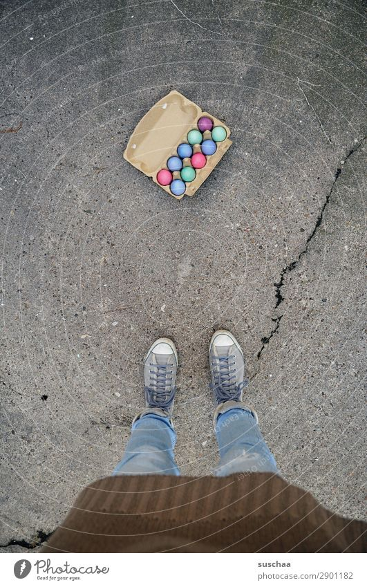 Easter eggs II Woman Human being Legs Feet Egg Eggs cardboard Feasts & Celebrations Tradition Multicoloured Colour Stand Street Asphalt Footwear Strange