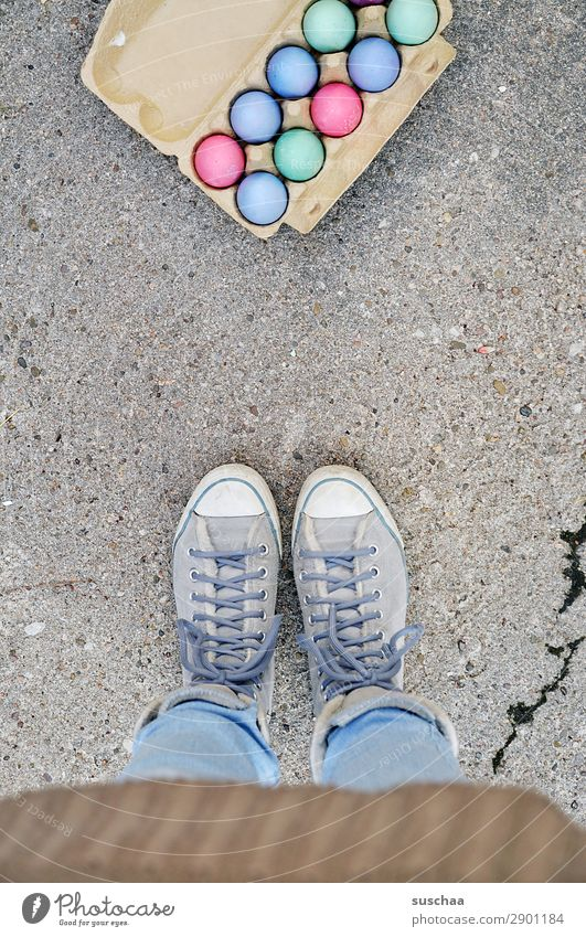 Easter eggs Woman Human being Legs Feet Egg Eggs cardboard Feasts & Celebrations Tradition Multicoloured Colour Stand Street Asphalt Footwear lace-up shoes