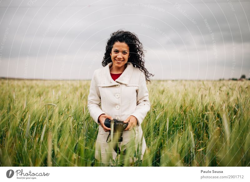 Girl with camera smiling in fields Lifestyle Photography Photographer Vacation & Travel Spring Camera Young woman Youth (Young adults) Woman Adults 1