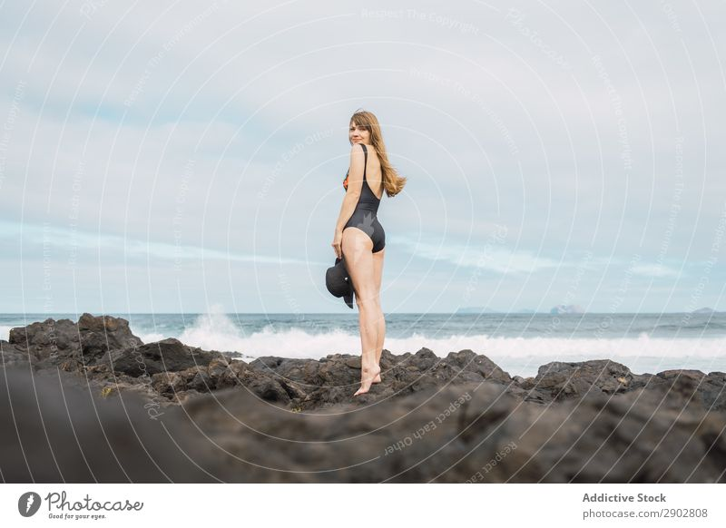 Sensual female near stormy sea Woman Ocean Coast Storm Swimwear Stand Lanzarote Spain Leisure and hobbies Waves Cloud cover Sky Weather To enjoy Swimsuit