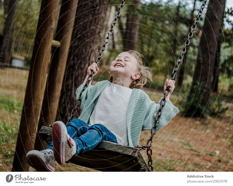 Smiling girl on swings in park Girl Forest Swing Park Child Positive Tree Nature Beautiful Woman Infancy Freedom Joy Wood Lifestyle Cheerful Fashion Garden