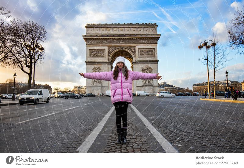 Girl standing against triumphal arch Triumphal Arch Street outstretched arms Tourism City Sky Clouds Freedom Gesture Youth (Young adults) Vacation & Travel Trip