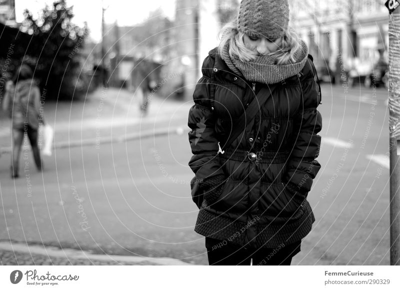 Walking down the street. Feminine Young woman Youth (Young adults) Woman Adults 1 Human being 18 - 30 years Town Street Pedestrian To go for a walk Coat