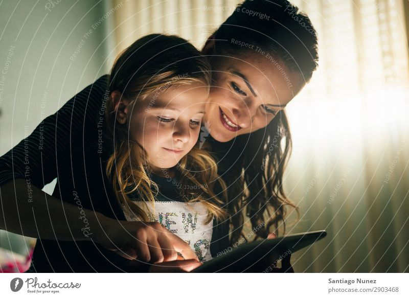 Mother and her child with digital tablet. Tablet computer Child Smiling Computer Playing Girl Family & Relations Education Small Daughter Son Together Digital