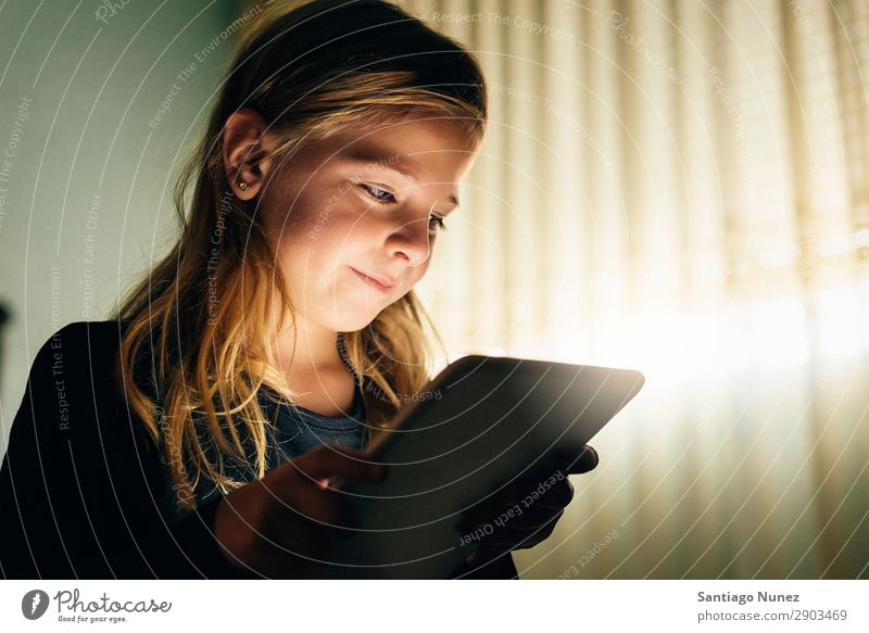 Sweet blondie girl playing on a Tablet PC. Tablet computer Child Smiling Computer Playing Girl Blonde Small Digital Home Happy Story Human being Technology Joy