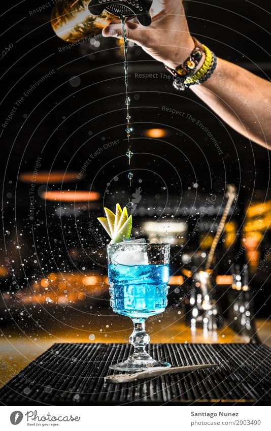 Barman pouring a cocktail into a glass Cocktail shaker martini bartender Glass Portion Boston Beverage Drinking Alcoholic drinks Gin Hand Nightclub Vodka