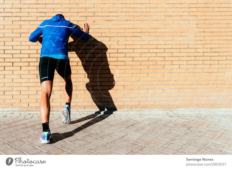 Handsome man running in the city. Fitness, workout, sport, lifestyle concept. Man Running Jogging Runner Street City Athlete Speed Lifestyle
