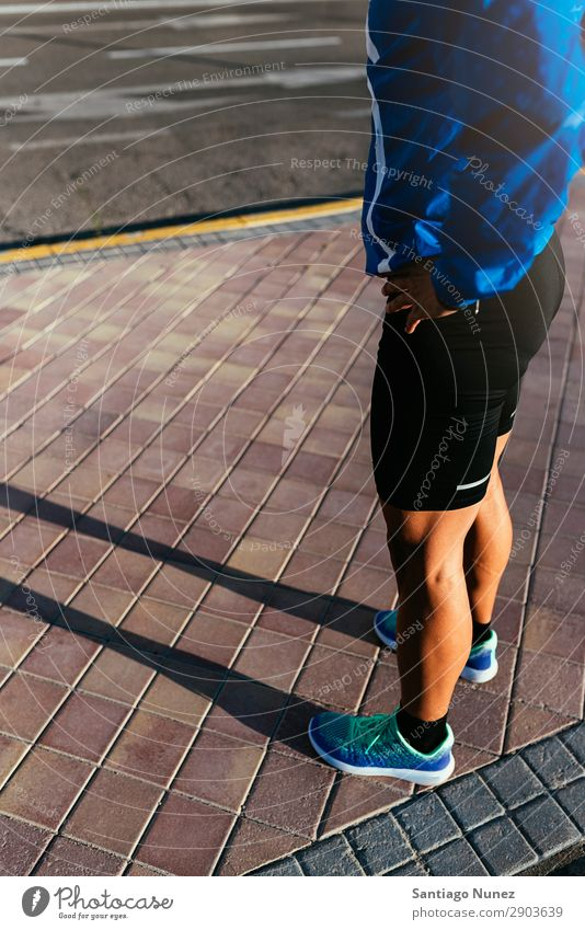 Close up of legs of runner in the city. Man Jogging Ready Break Legs Calf Relaxation Runner Street City Athlete Fitness Lifestyle Youth (Young adults) Town