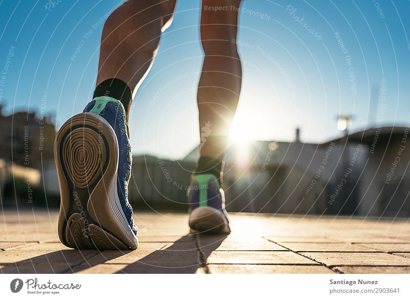 Close up of legs of runner in the city. Man Running Jogging Legs Calf Feet Runner Street City Athlete Speed Fitness Lifestyle Youth (Young adults) Town Action