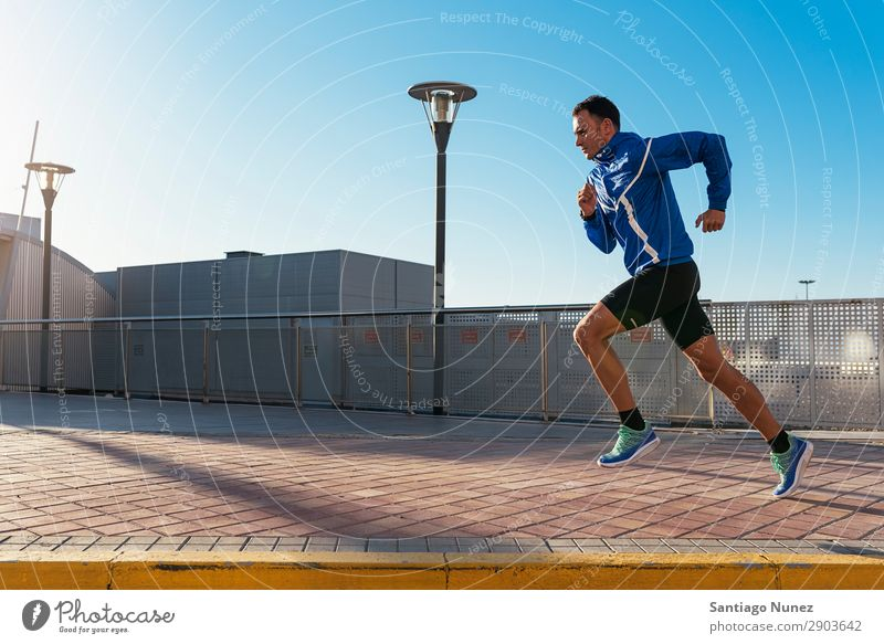 Handsome man running in the city. Man Running Jogging Runner Street City Athlete Speed Fitness Lifestyle Youth (Young adults) Town Action Shadow handsome