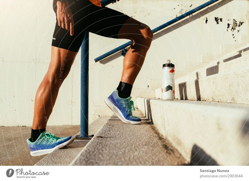Close up of legs stretching. Man Jogging Running Calf Musculature Runner Stretching Legs Street City Athlete Fitness Lifestyle Youth (Young adults) Town Break