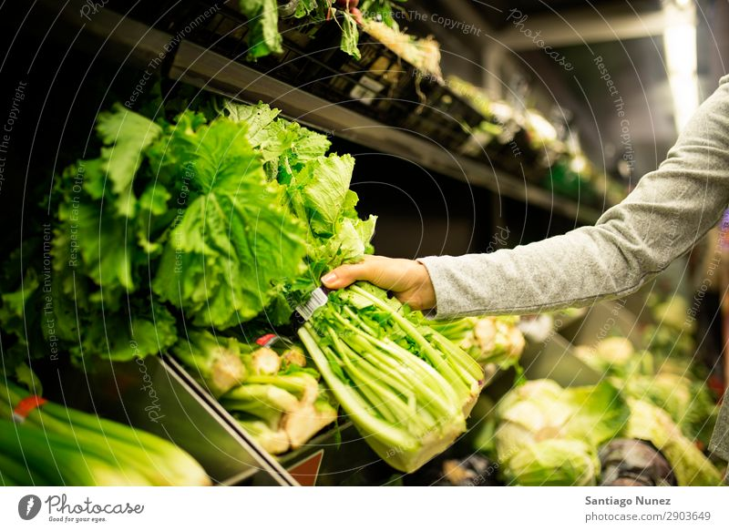 Close up of woman taking a lettuce in supermarket. Woman Shopping Supermarket Hand Take Close-up Food Markets using Human being Youth (Young adults) Smiling