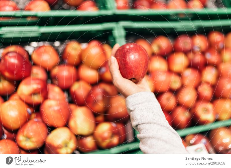 Beautiful woman choosing apples in supermarket. Fruit Supermarket Woman Close-up Storage Human being Apple Markets Food Hand Healthy Fresh Hold Shopping