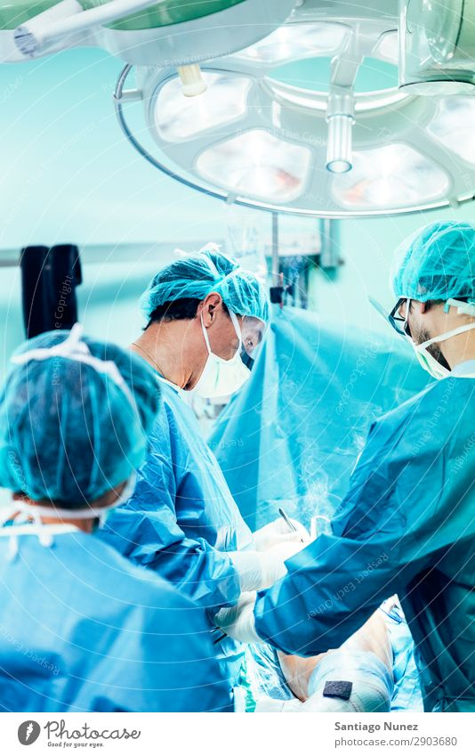 Team of Surgeons Operating. Operation Surgery operating surgical Hospital Room Doctor Theatre Medication Work and employment Group instrumental clinic Man Woman