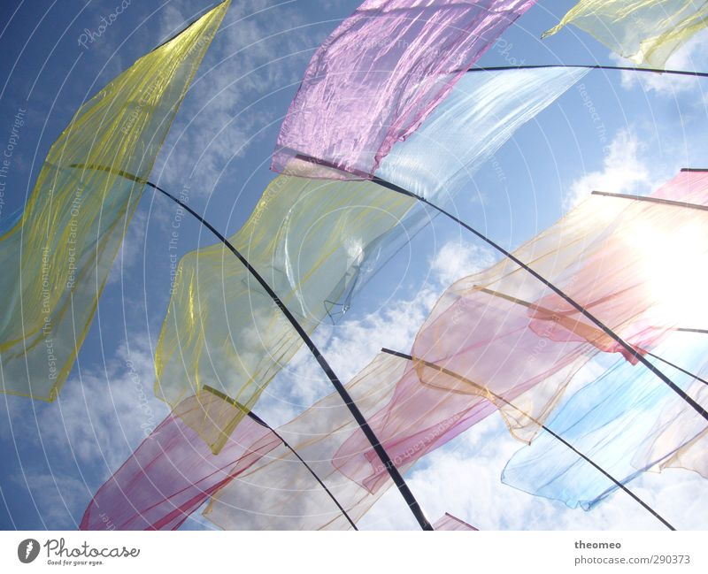 Flags in the wind Environment Landscape Air Sky Clouds Sun Beach North Sea Blue Multicoloured Yellow Wind Sky blue Flagpole Colour photo Exterior shot Deserted
