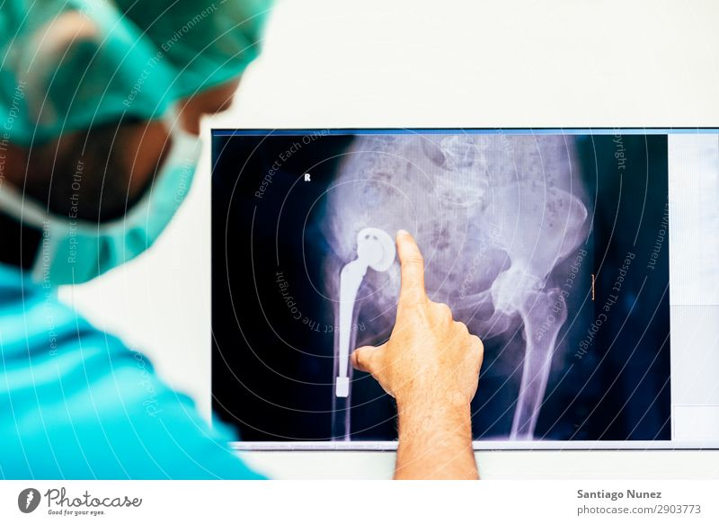 Medicine doctor looking x-ray image. Back backbone Bone Considerate Diagnosis Doctor Examinations and Tests examining Healthy Health care health-care Hospital
