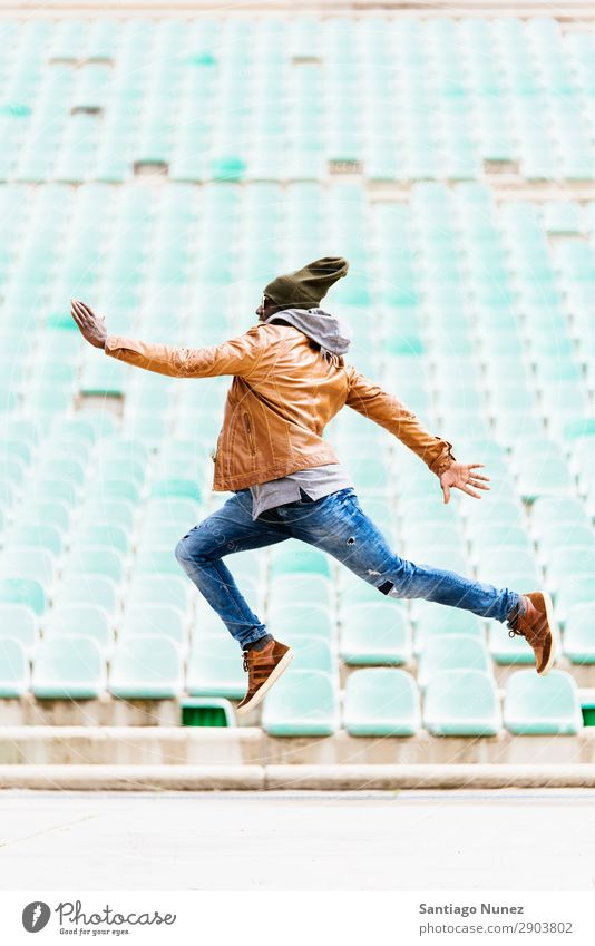 American man jumping in the park. Man Telephone Town Jump acting African Black Youth (Young adults) Human being Happy Happiness Smiling Laughter Cheerful