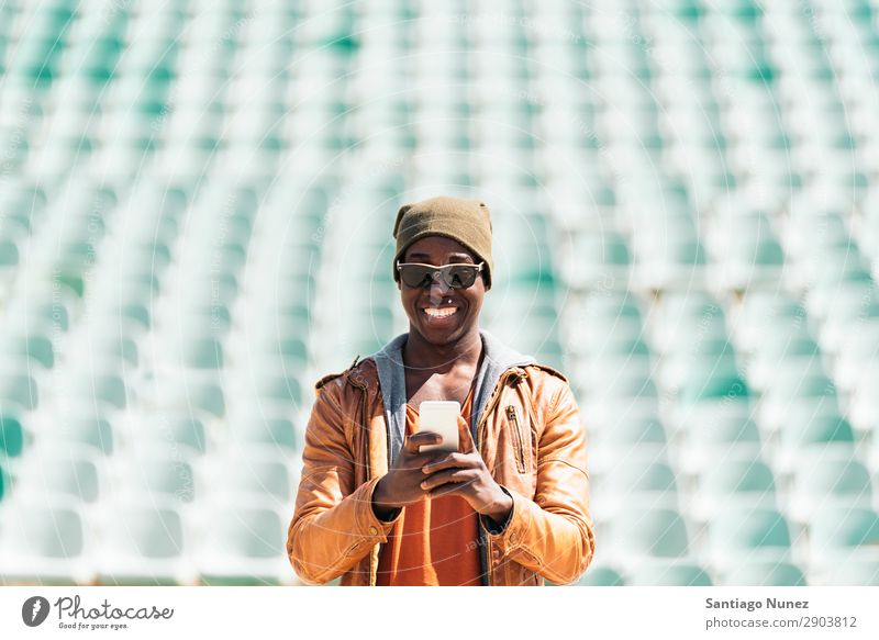 American man using mobile. Man Telephone Cellphone Town African Black Mobile Youth (Young adults) Laughter PDA Technology Human being Happy Happiness Smiling