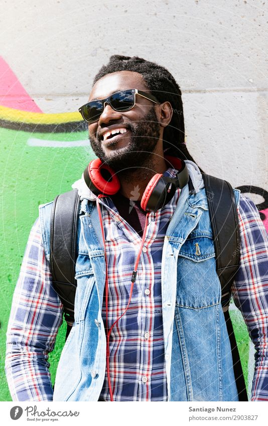 Portrait of a black man smiling. Adults African Afro American Attractive Background picture Black Headphones Easygoing Cool (slang) Expression Face handsome
