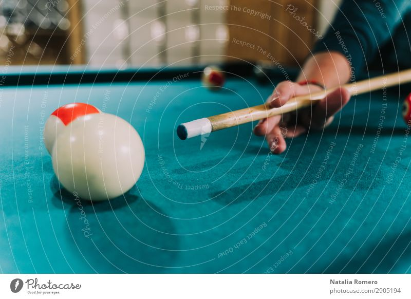 A hand with a tazo points to a billiard ball Joy Relaxation Swimming pool Leisure and hobbies Playing Table Night life Clubbing Sports Success Human being Man