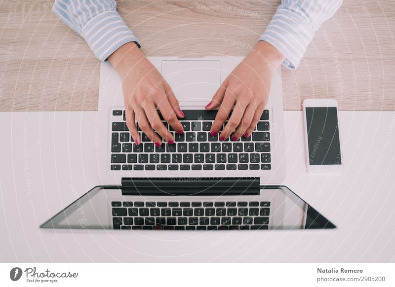 Business woman writing on her laptop Woman Human being Hand Lifestyle Adults Work and employment Technology Table Action Computer Fingers Touch Telephone