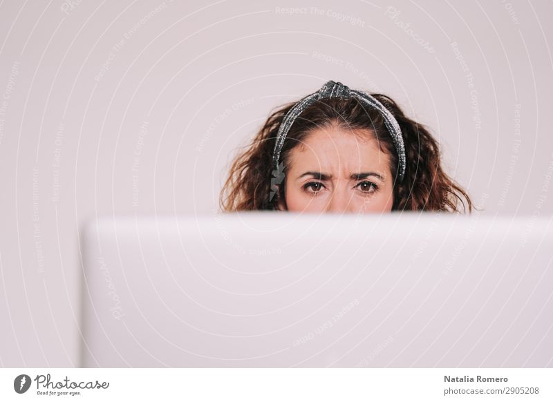 Brunette woman looking carefully at her computer screen Coffee Lifestyle Happy Desk Table Work and employment Office Business Telephone Computer Notebook
