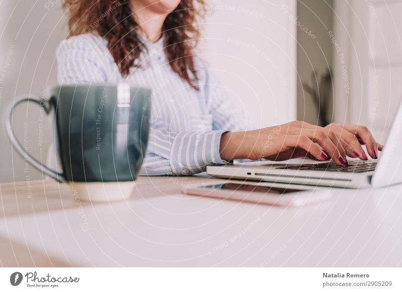 Business woman writing on her laptop Woman Human being Hand Lifestyle Adults Work and employment Technology Table Action Computer Fingers Touch Coffee Telephone