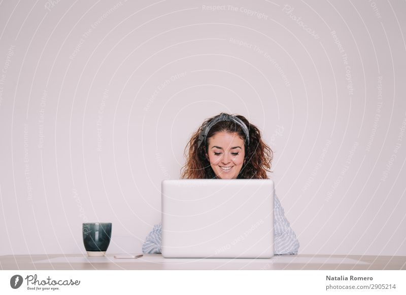 young woman writes something on her laptop Woman Human being Hand Lifestyle Adults Happy Business Work and employment Office Technology Smiling Sit Table Action