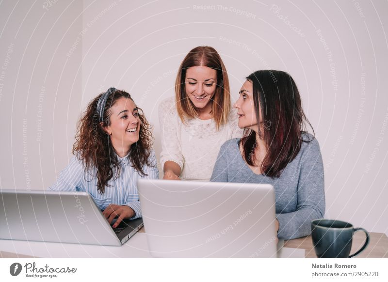 three women are laughing while working together in the office Happy Desk Work and employment Profession Workplace Office Business To talk Computer Notebook