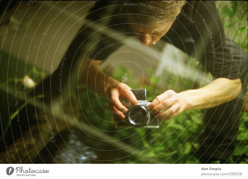 Human being Youth (Young adults) Young man Garden Masculine Perspective To hold on Camera Analog Take a photo