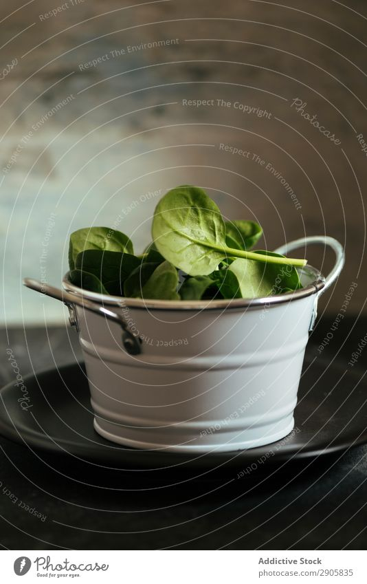 Fresh spinach on a rustic white metal crockery bowl Spinach Leaf Background picture Salad Food Vegetable