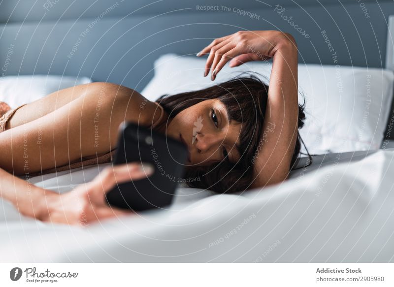 Woman with smartphone lying on bed Bed PDA Bedroom Home Lie (Untruth) using Resting Cellphone Youth (Young adults) Internet Communication Attractive Relaxation