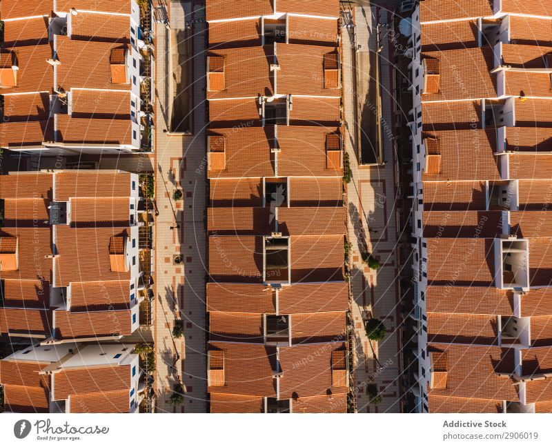 Orange rooftops of modern town from above Town drone view Remote Aircraft Gran Canaria agaete Spain Picturesque Exterior rows City Architecture Building Street