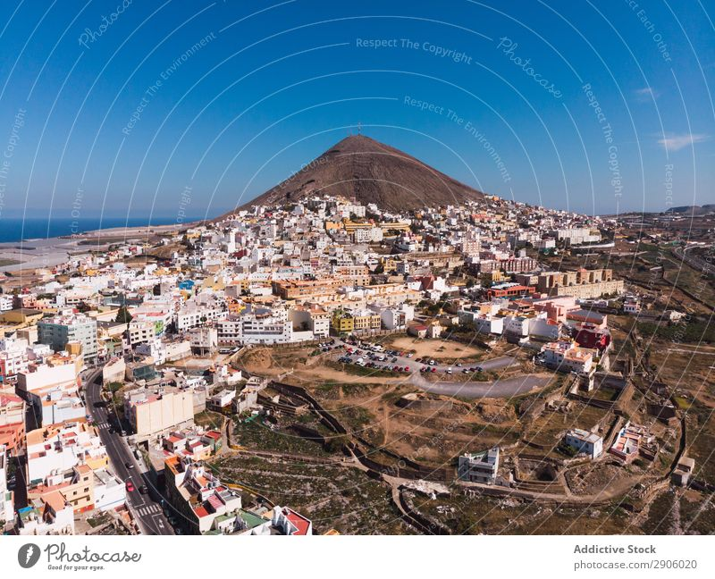 Landscape of town on coast of island Island City drone view Remote Aircraft Gran Canaria Spain Picturesque Vacation & Travel Bright Beautiful Blue sky Coast