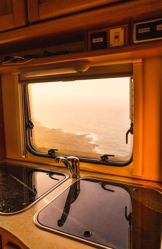 Retro camper van and picturesque view of sea Ocean Sunset Mountain Teide Tenerife Canaries Spain Picturesque Vantage point seascape Amazing Vintage Mobile home