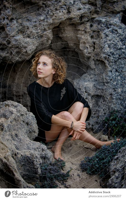 Young woman sitting between stones Woman Stone Attractive Sit Youth (Young adults) Charming Rock Lifestyle Curly Hair and hairstyles hairdo Calm
