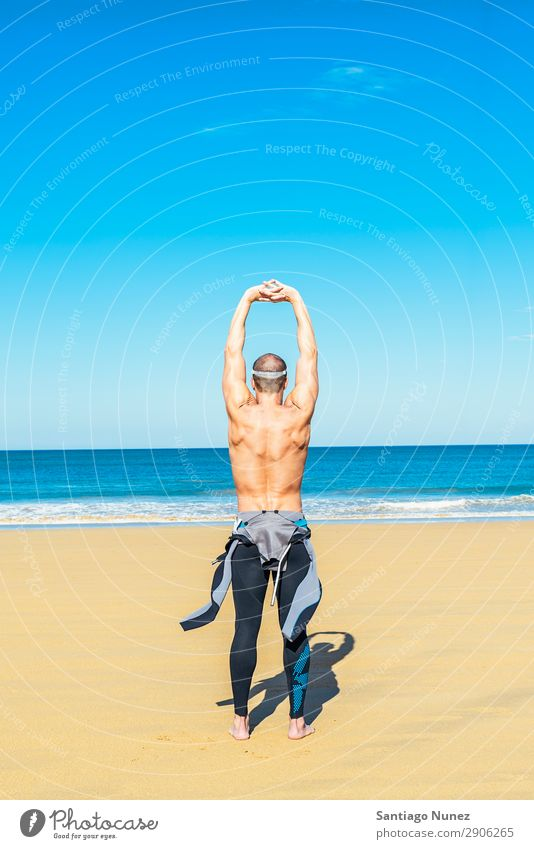 fitness man swimmer training stretching Beach Black Caucasian Diver Practice Athletic Fitness Person wearing glasses Skiing goggles handsome Healthy Lifestyle