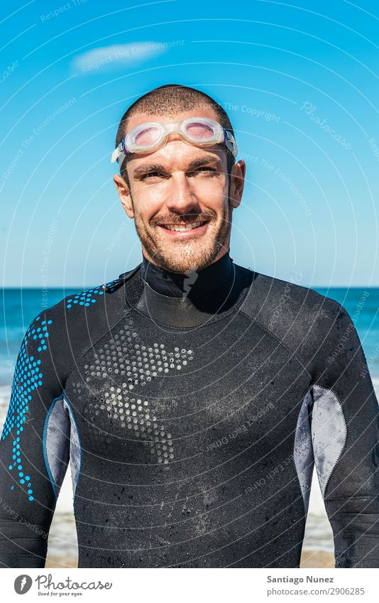 Handsoem Swimmer portrait on the beach Beach Black Caucasian Diver Practice Athletic Fitness Person wearing glasses Skiing goggles handsome Happy Healthy
