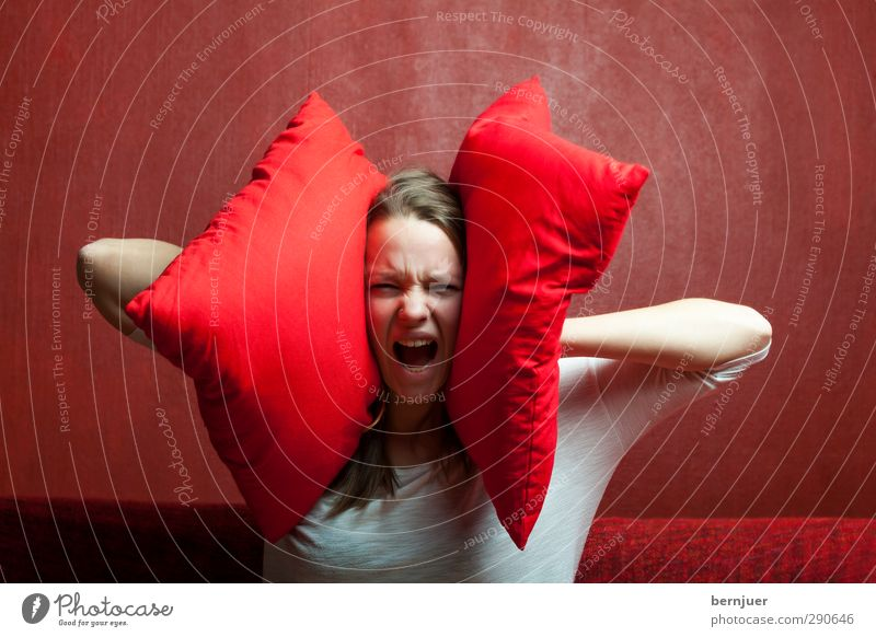 loundness Feminine Young woman Youth (Young adults) 18 - 30 years Adults Red Emotions Calm Exhaustion Fear Nerviness Cushion Sofa Crash Soundproofing