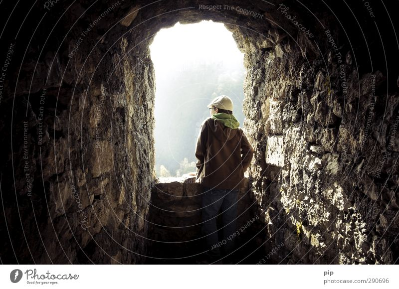 aperture Human being Masculine Youth (Young adults) Back 1 Spring Bad Urach Castle Ruin Tower Wall (barrier) Wall (building) Window hohenurach Observe Looking
