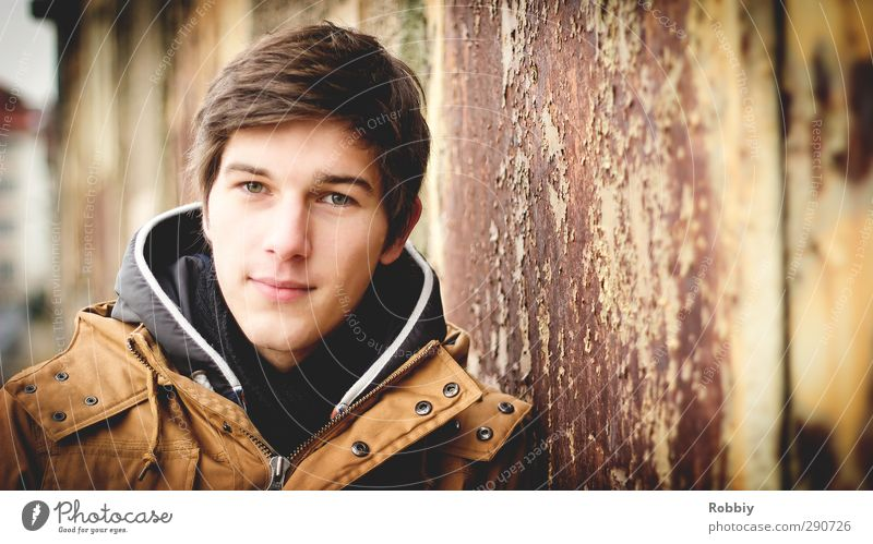 Un portrait rouillé I Masculine Young man Youth (Young adults) Head 1 Human being 18 - 30 years Adults Jacket Looking Stand Dirty Friendliness Town Brown Orange