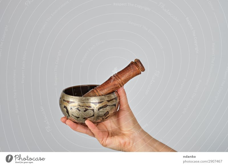 copper singing bowl and wooden stick in female hand Woman White Hand Relaxation Lifestyle Adults Religion and faith Body Metal Music Peace Meditation Bowl Yoga
