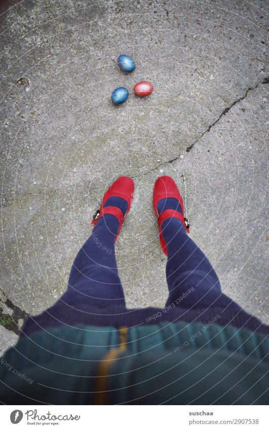 3 easter eggs on the street with legs Woman feminine Legs feet High heels Stand steady Tights Red Easter eggs Street Asphalt Crack & Rip & Tear Strange