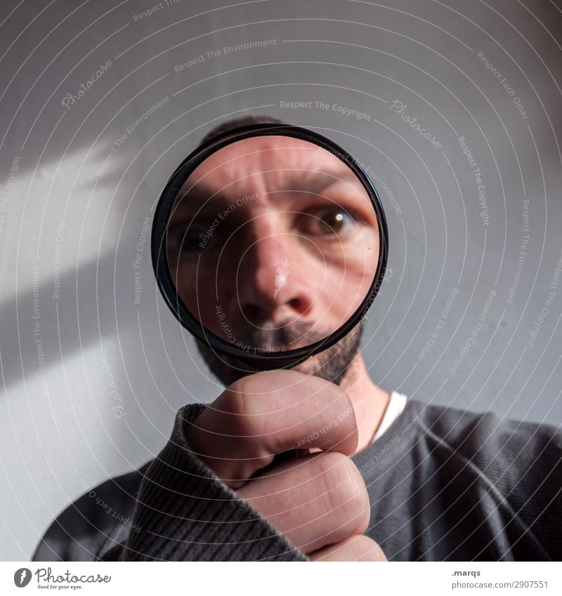 moon face Human being Man Adults Magnifying glass Looking Funny Near Interest Perspective Target Search Colour photo Interior shot Close-up Copy Space left
