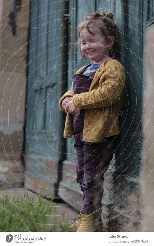 Human being Girl Feminine Grass Small Door Toddler Hide Gate Brunette Boots Old building Bangs Lean Varnish Short-haired